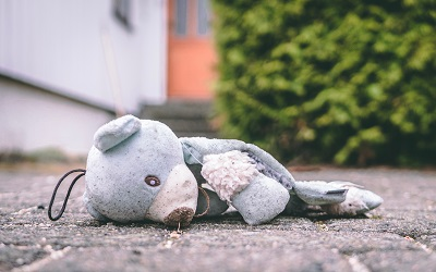 toy bear lying on the ground